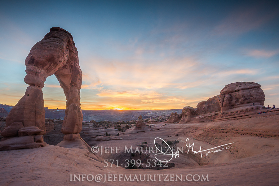 Sunset at Delicate Arch, located in Arches National Park, Utah.