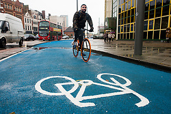 © Licensed to London News Pictures.06/11/2013. London, UK. A cyclist rides his bicycle on London's first segregated section of Barclays Cycle Superhighway that has been launched at Stratford High Street.Photo credit : Peter Kollanyi/LNP