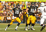 September 21 2013: Iowa Hawkeyes quarterback Jake Rudock (15) pulls up to throw during the first quarter of the NCAA football game between the Western Michigan Broncos and the Iowa Hawkeyes at Kinnick Stadium in Iowa City, Iowa on September 21, 2013. Iowa defeated Western Michigan 59-3.