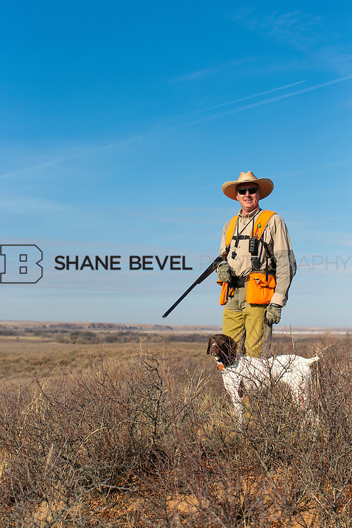 12/8/12 11:30:35 AM -- Quail hunting on the Cimarron Hills WMA in western Oklahoma. <br /> <br /> Photo by Shane Bevel