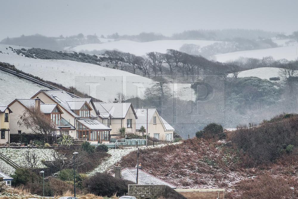 © Licensed to London News Pictures. 10/12/2017. Aberystwyth, Wales, UK. Aberystwyth, on the west coast of Mid Wales, is receiving its first snows of the winter, as the wintry conditions spread of much of the middle of the UK. The Met Office has issued Amber warnings for significant snowfall in the Midlands and over much of Wales, with the risk of severe disruption to travel. .Photo credit: Keith Morris/LNP