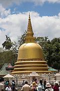 People at Dambulla Buddhist complex golden stupa, Sri Lanka, Asia