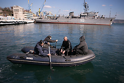 Relatives/friends row to deliver a couple bags of goods and food for the Ukrainian sailors parade on the warship in Sevastopol bay, Ukraine , Thursday, 13th March 2014. Picture by Daniel Leal-Olivas / i-Images