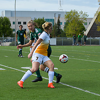 3rd year forward Brianna Wright (7) of the Regina Cougars jostles with Fraser Valley forward Desiree Caruso for possession during the Women's Soccer Homeopener on September 10 at U of R Field. Credit: Arthur Ward/Arthur Images