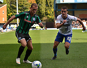 Rochdale Forward, Lewis Alessandra charges to the ball ahead of Bury defender Danny Pugh during the Sky Bet League 1 match between Bury and Rochdale at Gigg Lane, Bury, England on 17 October 2015. Photo by Mark Pollitt.