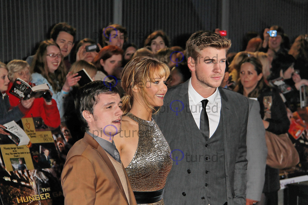 LONDON - MARCH 14: Josh Hutcherson, Jennifer Lawrence; Liam Hemsworth attend the Euorpean Film Premiere of 'The Hunger Games' at Cineworld, The O² Arena, London, UK. March 14, 2012. (Photo by Richard Goldschmidt)