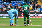 Jonny Bairstow of England starts tapping the stumps with the ball to see if they are working watched by Mohammad Saifuddin of Bangladesh after the ball hit the stumps but didn't dislodge the bails during the ICC Cricket World Cup 2019 match between England and Bangladesh the Cardiff Wales Stadium at Sophia Gardens, Cardiff, Wales on 8 June 2019.