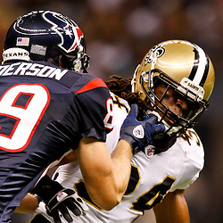 August 21, 2010; New Orleans, LA, USA; Houston Texans wide receiver David Anderson (89) grabs the facemask of New Orleans Saints cornerback Patrick Robinson (34) during the second half of a 38-20 win by the New Orleans Saints over the Houston Texans during a preseason game at the Louisiana Superdome. Mandatory Credit: Derick E. Hingle