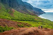 Hikers on the Kalalau Trail on the Na Pali Coast of the north shore of Kauai, Hawaii.