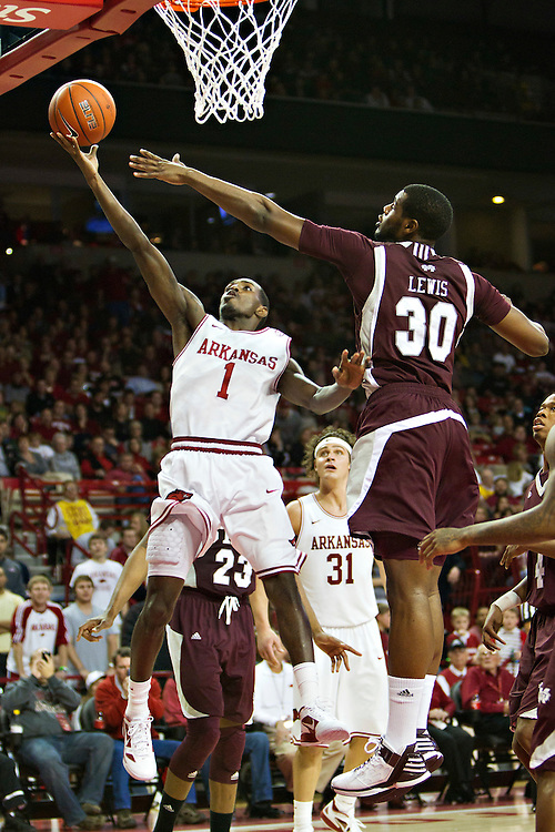 FAYETTEVILLE, AR - JANUARY 7:    Mardracus Wade #1 of the Arkansas Razorbacks drives to the basket for a lay up past Wendell Lewis #30 of the Mississippi State Bulldogs at Bud Walton Arena on January 7, 2012 in Fayetteville, Arkansas.  The Razorbacks defeated the Bulldogs 98-88.  (Photo by Wesley Hitt/Getty Images) *** Local Caption *** Mardracus Wade; Wendell Lewis