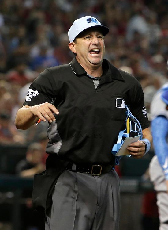 MLB umpire Jim Reynolds (77) in the first inning during a baseball game between the Arizona Diamondbacks and the New York Mets, Sunday, June 17, 2018, in Phoenix. (AP Photo/Rick Scuteri)