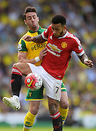 Memphis Depay of Manchester United does battle with Ivo Pinto of Norwich City during the Barclays Premier League match between Norwich City and Manchester United at Carrow Road, Norwich<br /> Picture by Richard Blaxall/Focus Images Ltd +44 7853 364624<br /> 07/05/2016