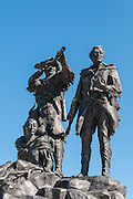 "William Clark, Meriwether Lewis and Sacagawea portrayed in the bronze statue ""Montana Memorial"" by sculptor Bob Scriver, located in the waterfront park on the Missouri River in Fort Benton, Montana."