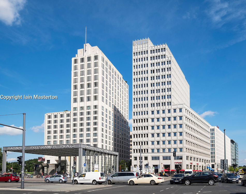 Modern office building with Ritz Carlton Hotel on left at Potsdamer Platz in Berlin, Germany