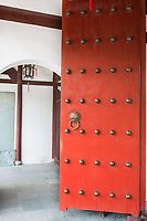 red doors detail of Wen Miao confucian confucius temple in Shanghai China popular republic