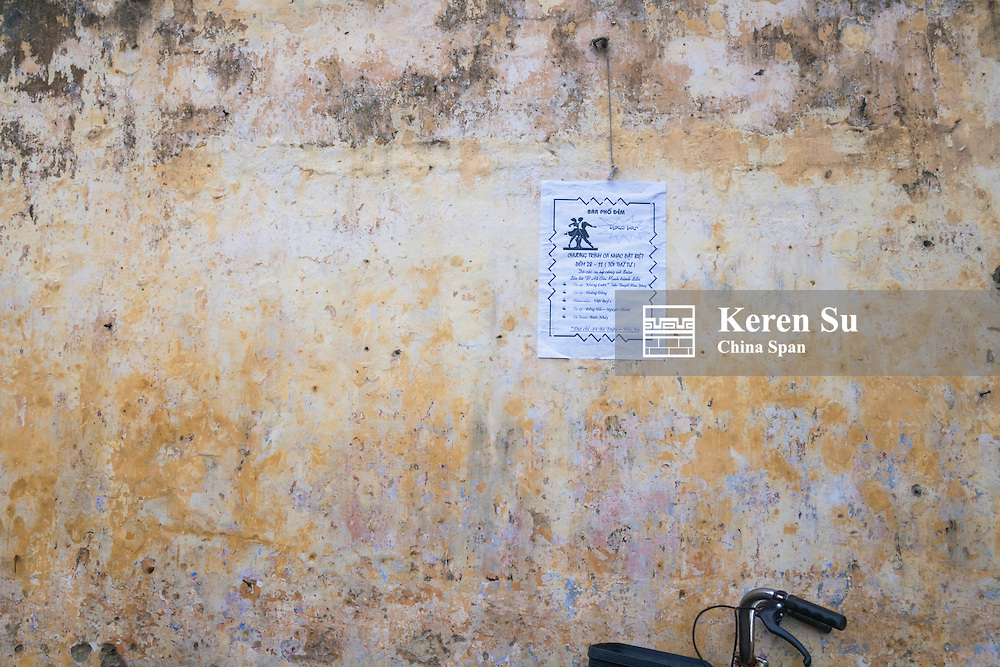 Poster on an old wall in Hoi An Ancient Town, UNESCO World Heritage site.