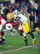 Arizona Cardinals wide receiver Brittan Golden (10) gets tackled returning the opening kickoff by Green Bay Packers strong safety Morgan Burnett (42) during the NFL NFC Divisional round playoff football game against the Green Bay Packers on Saturday, Jan. 16, 2016 in Glendale, Ariz. The Cardinals won the game in overtime 26-20. (©Paul Anthony Spinelli)