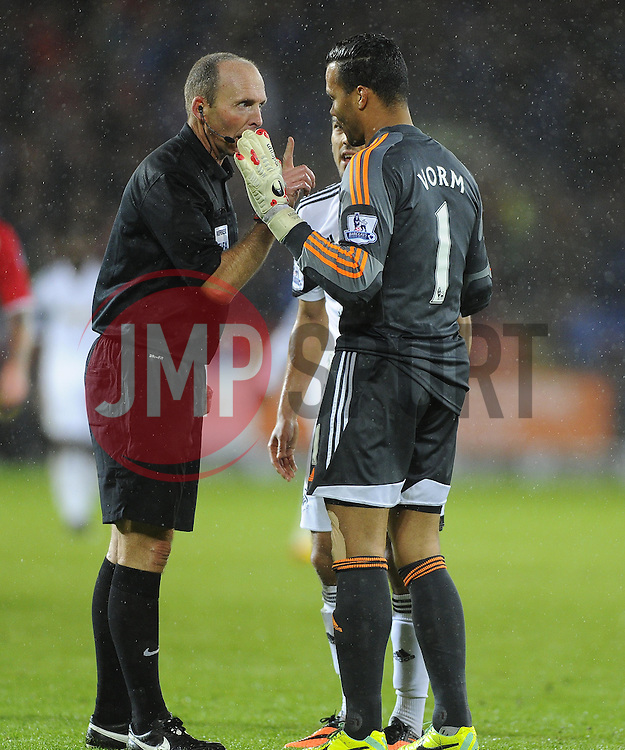 Referee, Mike Dean shows Swansea City's Michel Vorm the red card for his could on Cardiff City's Fraizer Campbell - Photo mandatory by-line: Joe Meredith/JMP - Tel: Mobile: 07966 386802 03/11/2013 - SPORT - FOOTBALL - The Cardiff City Stadium - Cardiff - Cardiff City v Swansea City - Barclays Premier League