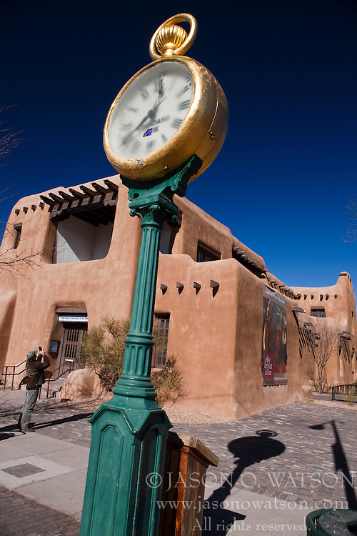 Golden clock outside of the New Mexico Art Museum, Santa Fe, New Mexico, United States of America