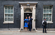 Following a meeting with the Queen, David and Samantha Cameron stand on the doorstep of 10 Downing Street.