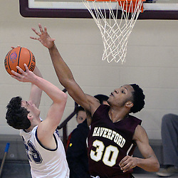 TOM KELLY IV - DAILY TIMES<br /> Haverford's Lamar Stevens (30) plays some good defense against Episcopal's Nick Alikakos (23) during the Episcopal Academy vs The Haverford School boys basketball game as part of the Daniel Dougherty tournament at Philadelphia University on Saturday, January 3, 2015.