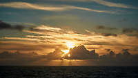 Sun Rising through the Clouds from the Deck of the MV Explorer. Image taken with a Nikon 1 V1 camera and 30-110 mm lens (ISO 100, 39 mm, f/16, 1/125 sec).