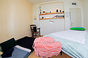 An empty holistic masseuse treatment bed and room