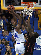 Nov 15, 2019; Los Angeles, CA, USA; UCLA Bruins forward Jalen Hill (24) is defended by UNLV Rebels guard Marvin Coleman (31)  in the first half at Pauley Pavilion. UCLA defeated UNLV 71-54.