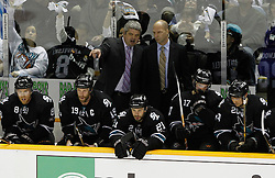 May 8, 2011; San Jose, CA, USA; San Jose Sharks head coach Todd McLellan (top, left) talks to assistant coach Matt Shaw (top, right) during the first period of game five of the western conference semifinals of the 2011 Stanley Cup playoffs against the Detroit Red Wings at HP Pavilion. Mandatory Credit: Jason O. Watson / US PRESSWIRE