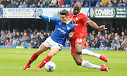 Stephane Zubar challenging Conor Chaplin during the Sky Bet League 2 match between Portsmouth and York City at Fratton Park, Portsmouth, England on 2 May 2015. Photo by Michael Hulf.