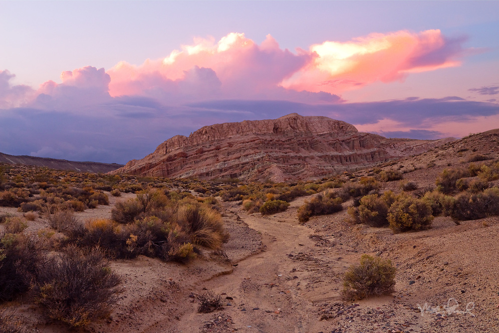 Seeing the thunderheads building over the Mojave Desert, I decided to drive to Red Rock Canyon for some hiking and see if there was a decent shot. I wandered over the ridge into a side canyon up a gully coming upon this colorful mesa.