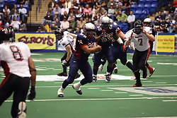 14 April 2007: Rocky Harvey finds some running room in the gap during a United Indoor Football League game that pitted the RiverCity Rage who won 29-11 against the Bloomington Extreme at the U.S. Cellular Coliseum in Bloomington Illinois..