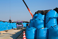 10 000 bags of contaminated soil are being stored on a mountain in the village Shidamayo, 27 km from The Fukushima Daiichi Nuclear Power Plant. The bags will be stored at the mountain location for five years, then the bags will be move to Futaba, a town closer to the Nuclear Power Pant. Fukushima Prefecture, Japan<br />