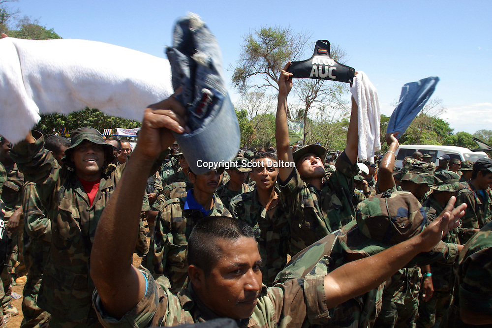 Members of the paramilitary group Bloque Norte, or Northern Block, celebrate during a disarmament ceremony in La Mesa in northern Colombia on March 10, 2006. An estimated 24,000 paramilitary members have turned in their weapons as part of a government negotiated peace deal. But some are skeptical if the government plan will really work and if the paramilitary members will be successful in their transformation to civilian life. (Photo/Scott Dalton)