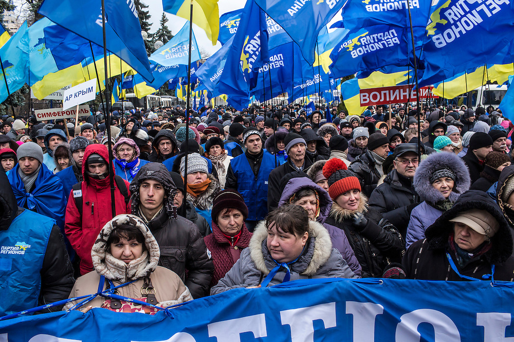 KIEV, UKRAINE - DECEMBER 5: People attend a rally in support of the government held by President Viktor Yanukovych's ruling Party of Regions near the Ukrainian parliament on December 5, 2013 in Kiev, Ukraine. Thousands of people have been protesting against the government since a decision by Ukrainian president Viktor Yanukovych to suspend a trade and partnership agreement with the European Union in favor of incentives from Russia. (Photo by Brendan Hoffman/Getty Images) *** Local Caption ***