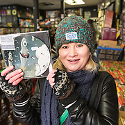 Music fans out in their numbers for Record Store Day. The Love Music shop on Dundas Street, Glasgow. A shivering Claire Thomson of Glasgow with the Muse record she waited for since 5am. Picture Robert Perry 16th April 2016<br /> <br /> Must credit photo to Robert Perry<br /> FEE PAYABLE FOR REPRO USE<br /> FEE PAYABLE FOR ALL INTERNET USE<br /> www.robertperry.co.uk<br /> <br /> NB -This image is not to be distributed without the prior consent of the copyright holder.<br /> in using this image you agree to abide by terms and conditions as stated in this caption.<br /> All monies payable to Robert Perry<br /> <br /> (PLEASE DO NOT REMOVE THIS CAPTION)<br /> This image is intended for Editorial use (e.g. news). Any commercial or promotional use requires additional clearance. <br /> Copyright 2016 All rights protected.<br /> first use only<br /> contact details<br /> Robert Perry     <br /> 07702 631 477<br /> robertperryphotos@gmail.com<br />        <br /> Robert Perry reserves the right to pursue unauthorised use of this image . If you violate my intellectual property you may be liable for  damages, loss of income, and profits you derive from the use of this image.