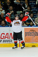 KELOWNA, CANADA, OCTOBER 26: Jarrett Fontaine #32 of the Prince George Cougars celebrates a goal against the Kelowna Rockets as the Prince George Cougars visit the Kelowna Rockets  on October 26, 2011 at Prospera Place in Kelowna, British Columbia, Canada (Photo by Marissa Baecker/Shoot the Breeze) *** Local Caption *** Jarrett Fontaine;