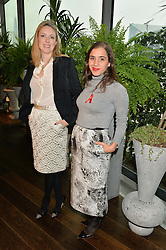 Left to right, STEPHANIE PHAIR president of the OUTNET.COM and CEANNE FERNANDES-WONG Head of Global Marketing at THE OUTNET.COM<br />  at the mothers2mothers World AIDS Day VIP Lunch with Next Management & THE OUTNET.COM held at Mondrian London, 19 Upper Ground, London on 1st December 2014.