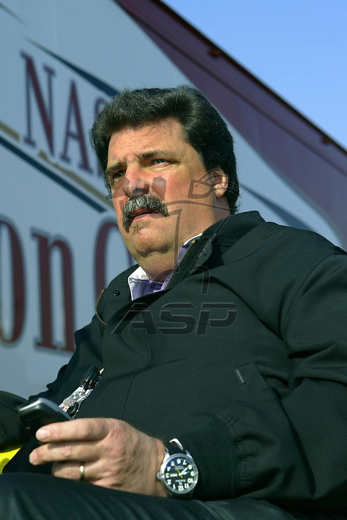 Mike Helton sits at the Winston Cup hauler before the start of the Auto Club 500 NASCAR Winston Cup race at the California Speedway in Fontana, California.