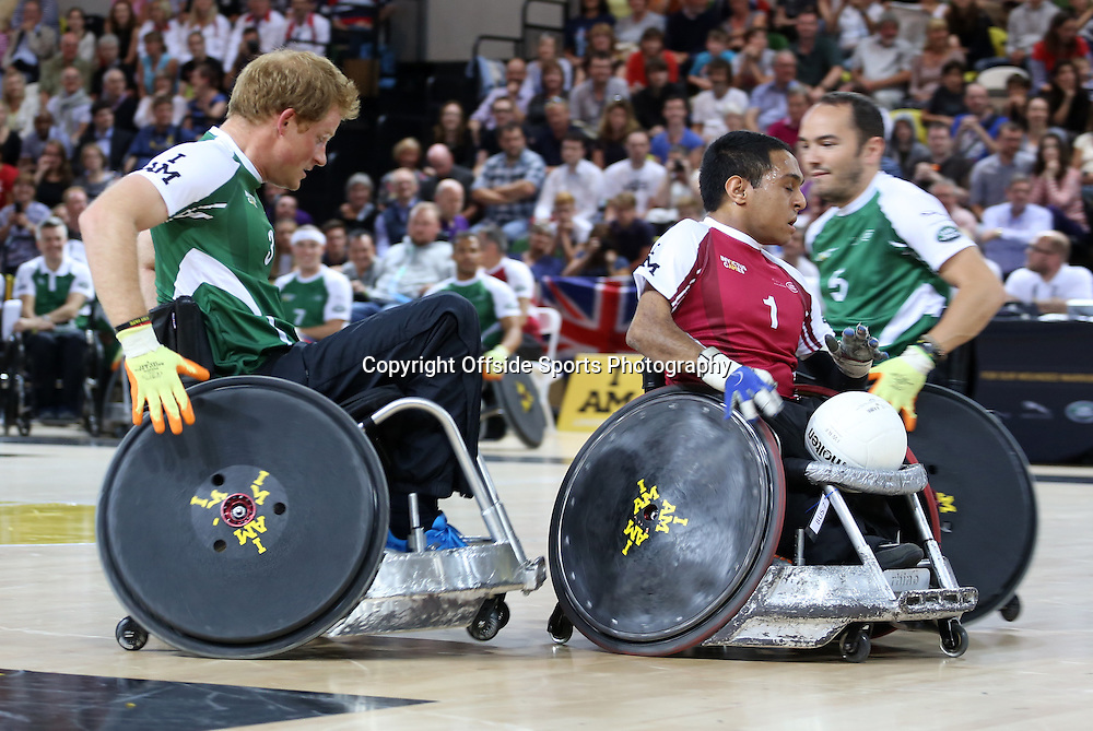 12 September 2014 - Invictus Games Day 2 - Wheelchair Rugby Celebrity Match - His Royal Highness Prince Harry chases down Ayaz Bhuta.<br /> <br /> Photo: Ryan Smyth/Offside