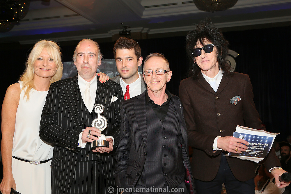 (L-R) Gabby Roslin, MIck Jones, Sam Slee - O2, Nick Headon, John Cooper Clark. The Silver Clef Lunch 2013 in aid of  Nordoff Robbins held at the London Hilton, Park Lane, London.<br /> Friday, June 28, 2013 (Photo/John Marshall JME)