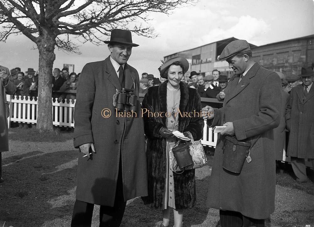 Irish Grand National at Fairyhouse (Easter Monday)..Mr and Mrs J. A. Wood (left and centre) owners of 'Overshadow' who won the Irish National..Mr Magnier (right), trainer and part owner of Overshadow.06/04/1953