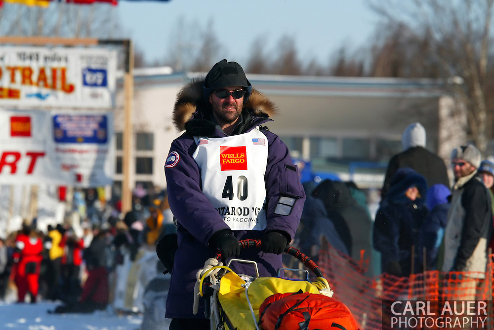 3/4/2007:  Willow, Alaska -  The dogs lead Rookie Scott White of Snohomish, WA across the snow and ice at the start of the 35th Iditarod Sled Dog Race