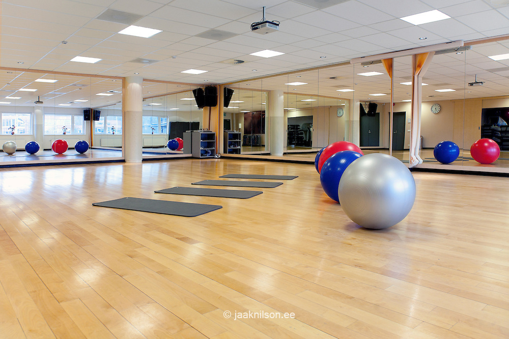Row of exercise balls and workout room, gymnasium with wooden floor in Viimsi spa hotel in Tallinn, Estonia