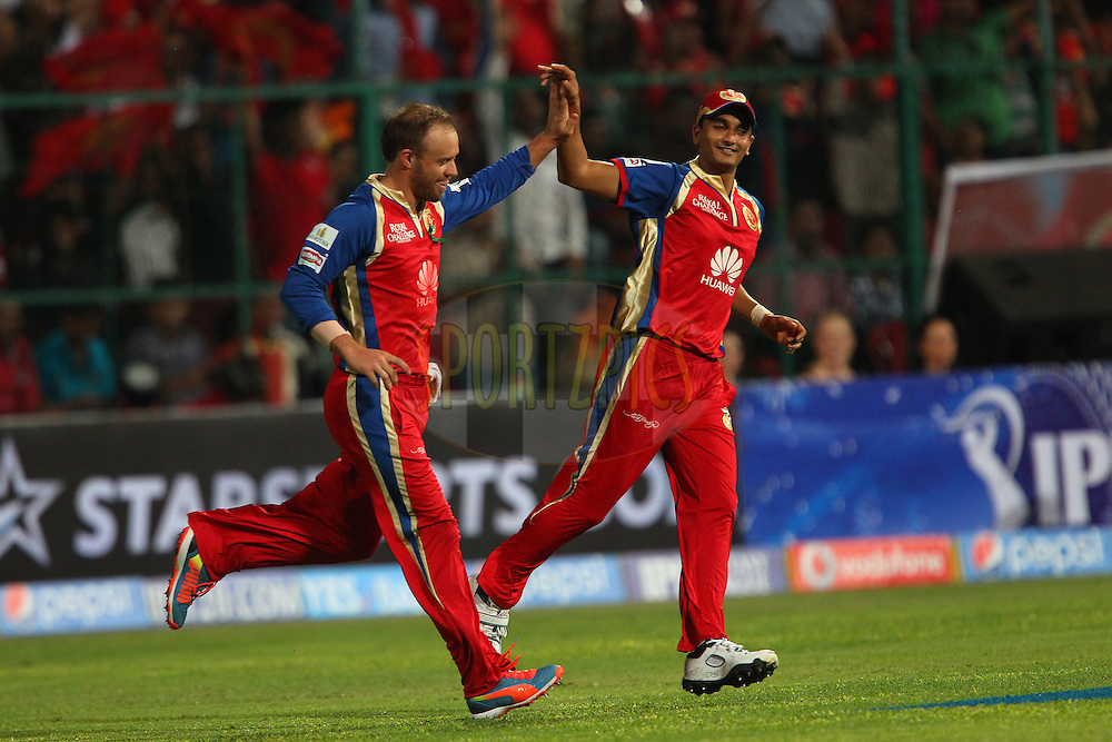 AB de Villiers of the Royal Challengers Bangalore and Harshal Patel of the Royal Challengers Bangalore celebrate the wicket of Shikhar Dhawan captain of the Sunrisers Hyderabad during match 24 of the Pepsi Indian Premier League Season 2014 between the Royal Challengers Bangalore and the Sunrisers Hyderabad held at the M. Chinnaswamy Stadium, Bangalore, India on the 4th May  2014<br /> <br /> Photo by Ron Gaunt / IPL / SPORTZPICS<br /> <br /> <br /> <br /> Image use subject to terms and conditions which can be found here:  http://sportzpics.photoshelter.com/gallery/Pepsi-IPL-Image-terms-and-conditions/G00004VW1IVJ.gB0/C0000TScjhBM6ikg