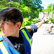 5/31/09 -- BATH, Maine. Patrol and Canine Officer Michelle Small directs traffic at the entrance to the Bath YMCA on Sunday morning. Sunday morning's Triathalon drew nearly 200 participants and over 100 volunteers to the Bath YMCA. Winners were Kurt Perham for the men and Alicia Trott, both of Brunswick. Photo by Roger S. Duncan.