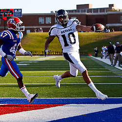 December 4, 2010; Ruston, LA, USA; Nevada Wolf Pack quarterback Colin Kaepernick (10) scores past Louisiana Tech Bulldogs safety Javontay Crowe (47) during the first half at Joe Aillet Stadium.  Mandatory Credit: Derick E. Hingle