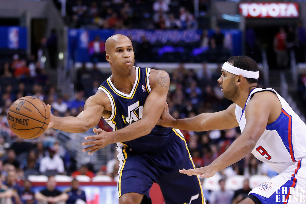 23 October 2013: Utah Jazz small forward Richard Jefferson (24) passes the ball past Los Angeles Clippers shooting guard Jared Dudley (9) during the Los Angeles Clippers 103-99 victory over the Utah Jazz at the Staples Center, Los Angeles, California, USA.