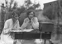 Southern Cross  Atlantic Flight: Two women operating radio equipment, June 1930.<br /> (Part of the Independent Newspapers Ireland/NLI Collection)