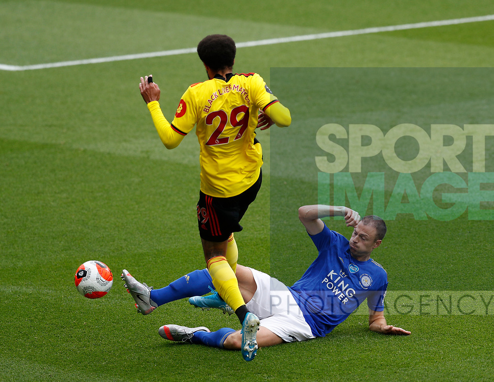 Jonny Evans of Leicester City tackles Etiene Capoue of Watford during the Premier League match at Vicarage Road, Watford. Picture date: 20th June 2020. Picture credit should read: Darren Staples/Sportimage